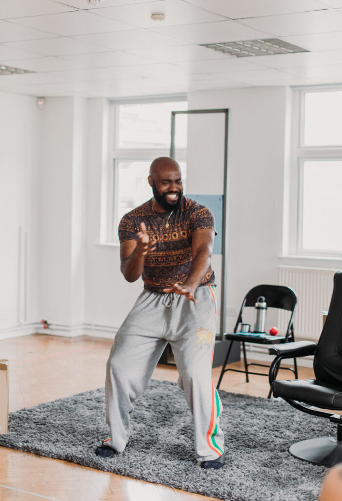 Actor Joesph Black dances on stage as his character Tunde during rehearsals for Sessions