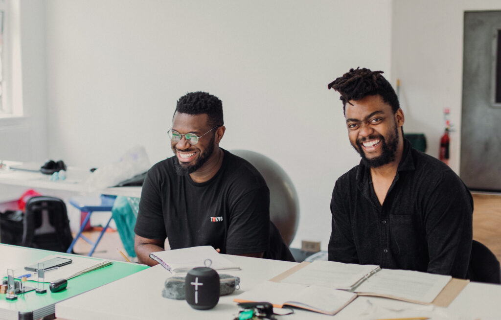 Director Philip Morris and Assistant Director David Gilbert smile at the camera during rehearsals for Sessions.